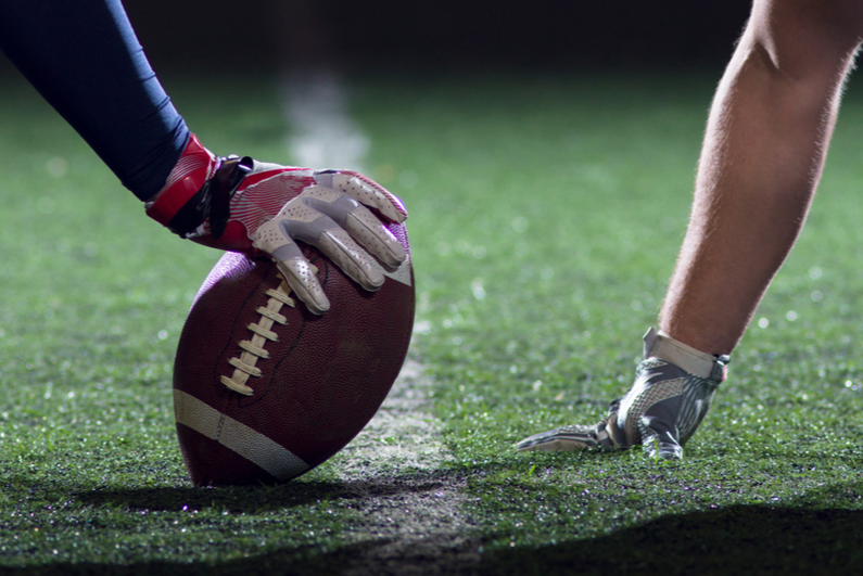 Football players ready to snap ball