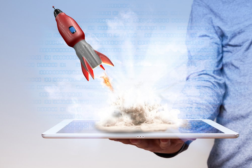 rocket launching out of a tablet