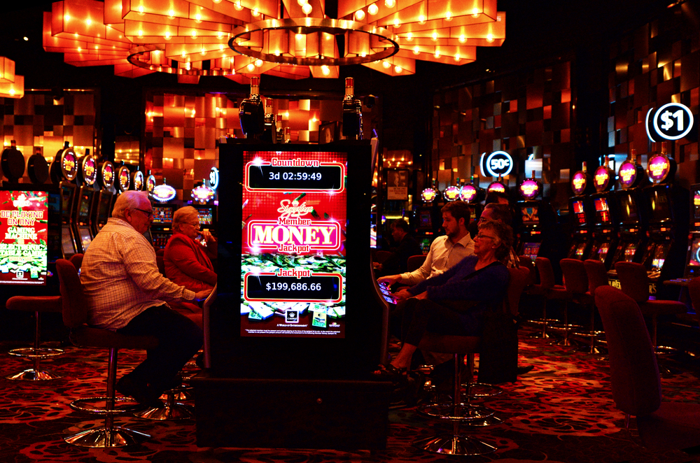 patrons playing at games machines at Crown Casino Melbourne