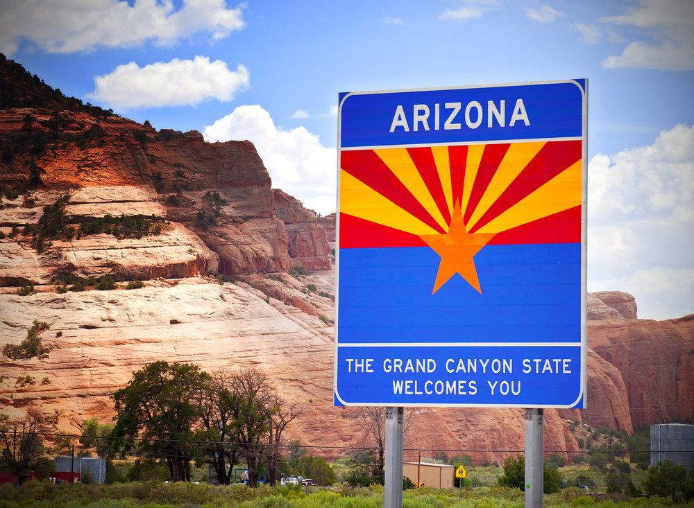 Arizona welcome sign with mountains in the background