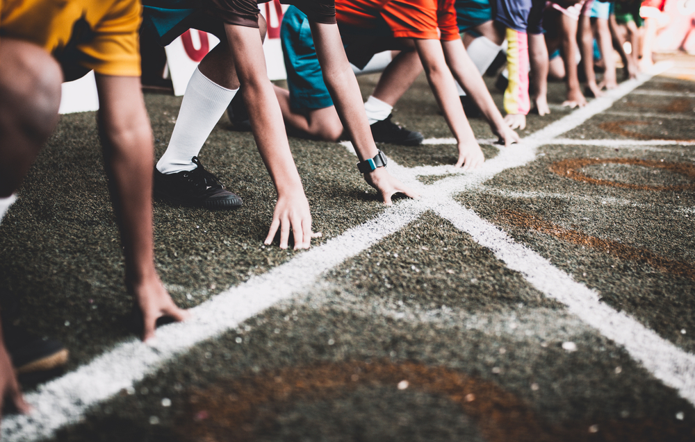 athletes lined up at the starting line of a race