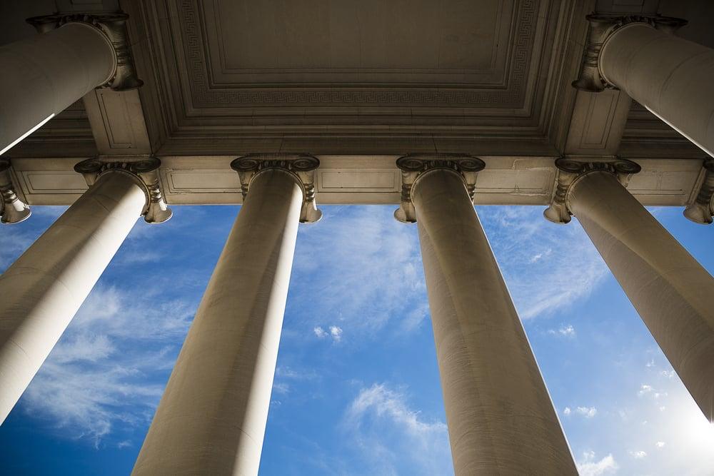building columns against a blue sky backdrop