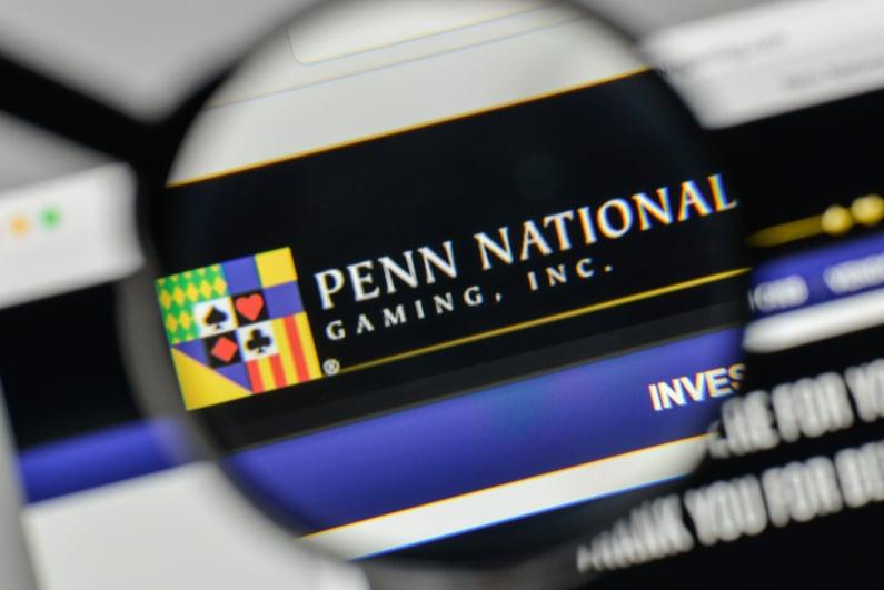 Penn National logo on computer through magnifying glass