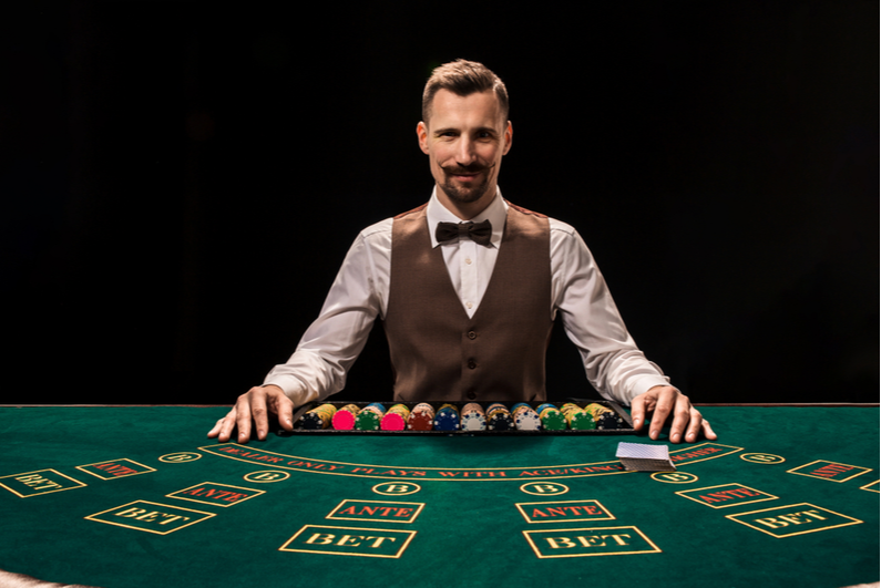 Hipster-looking table game dealer