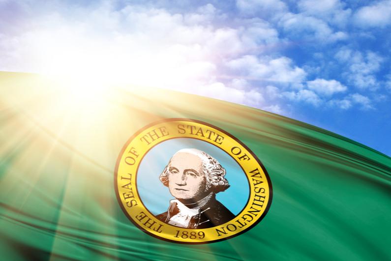 Washington state flag in front of a sunburst