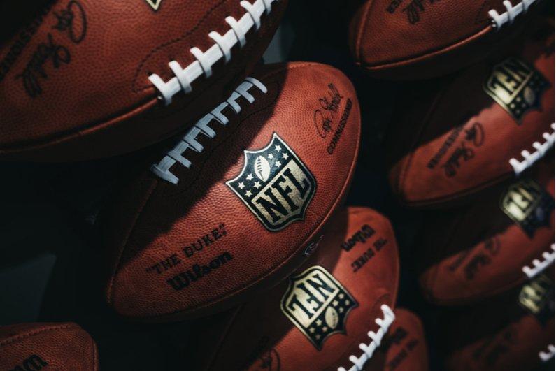 Row of NFL footballs