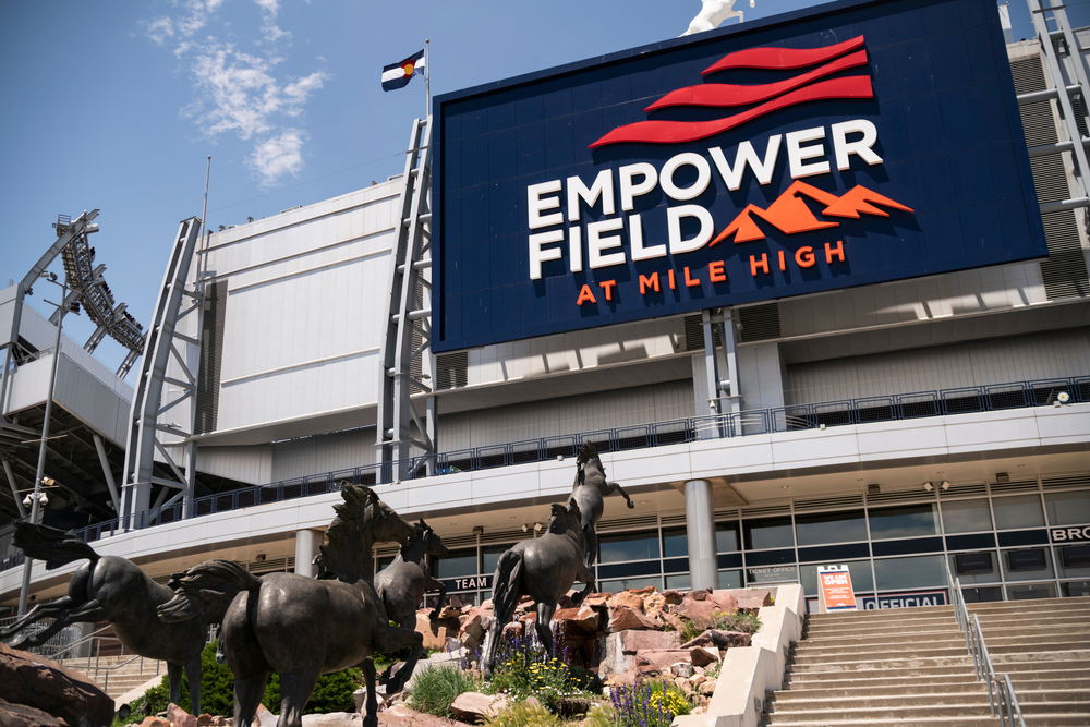 Empower Field at Mile High Stadium with charging Broncos statues