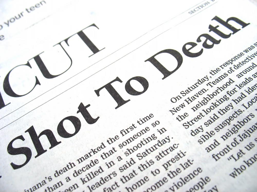 """newspaper headline reads """"shot to death"""""""