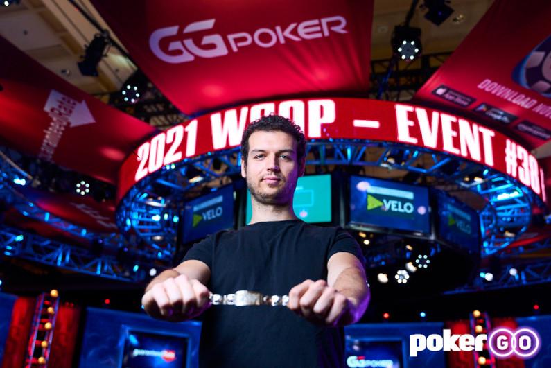 Michael Addamo holding his WSOP bracelet