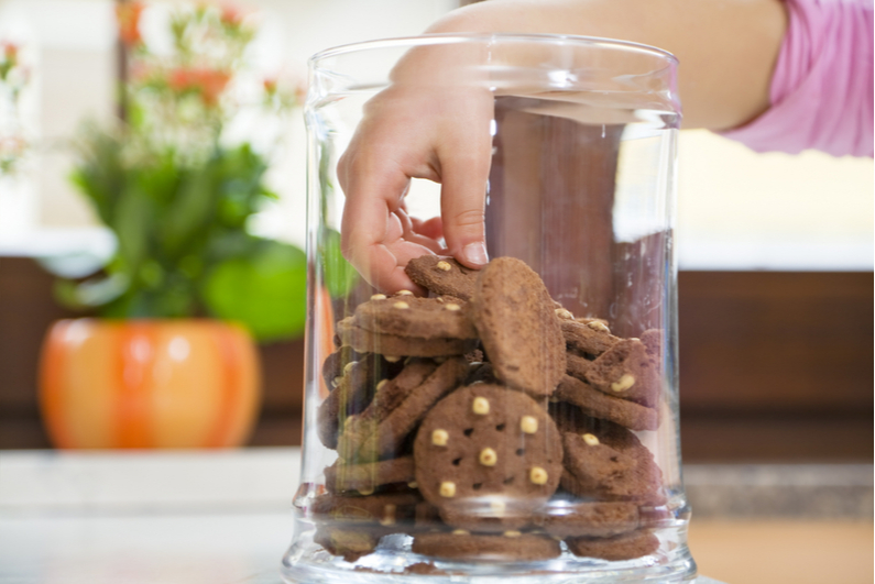 Hand stealing from a cookie jar