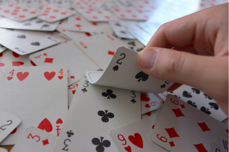 Showing 2 of clubs on top of a mess of face-up cards