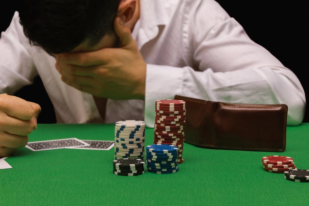 Gambler with head in hands