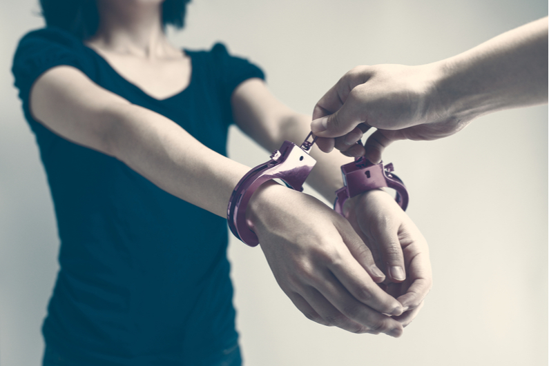 Woman getting handcuffed